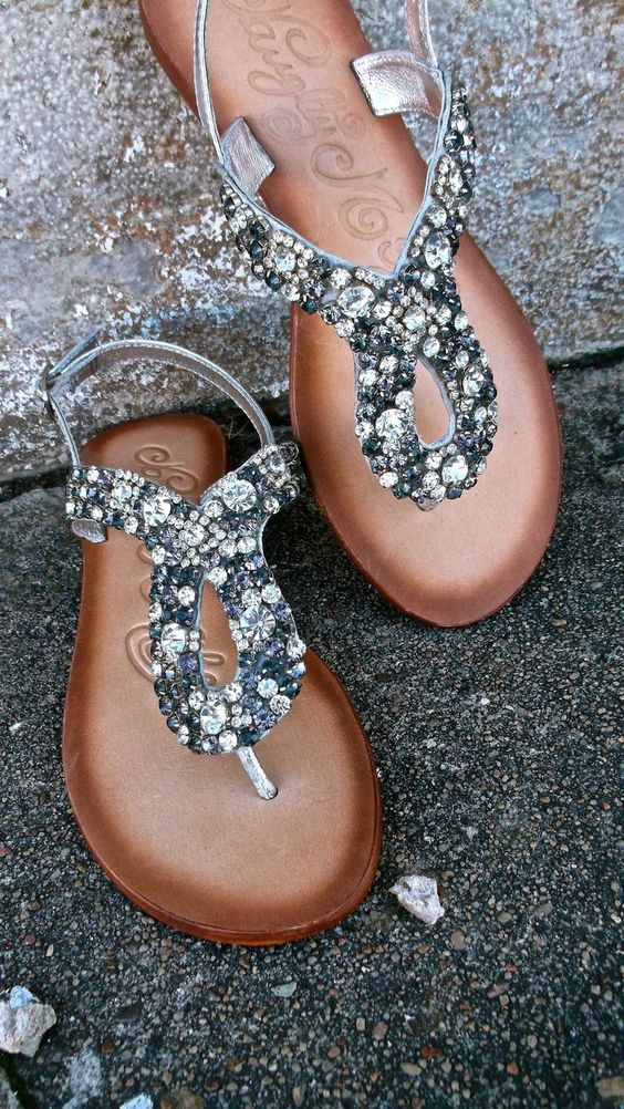 thong sandals with grey and silver crystals and 8 sign