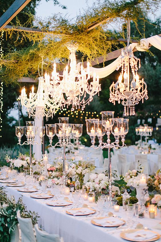 chandeliers over the tables will create a chic glam look
