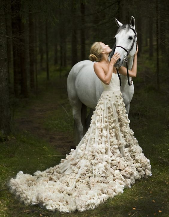 strapless ivory wedding dress wiht a train and lots of soft floral appliques