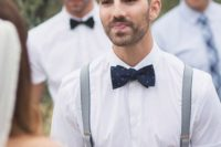 31 a cotton white shirt with short sleeves, a navy bow tie and suspenders to go