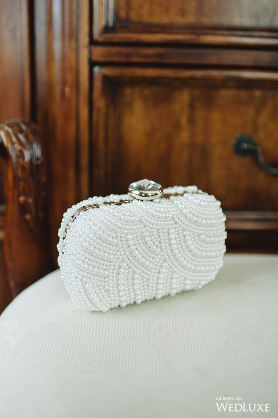 gorgeous pearl curve wedding clutch with an oversized rhinestone