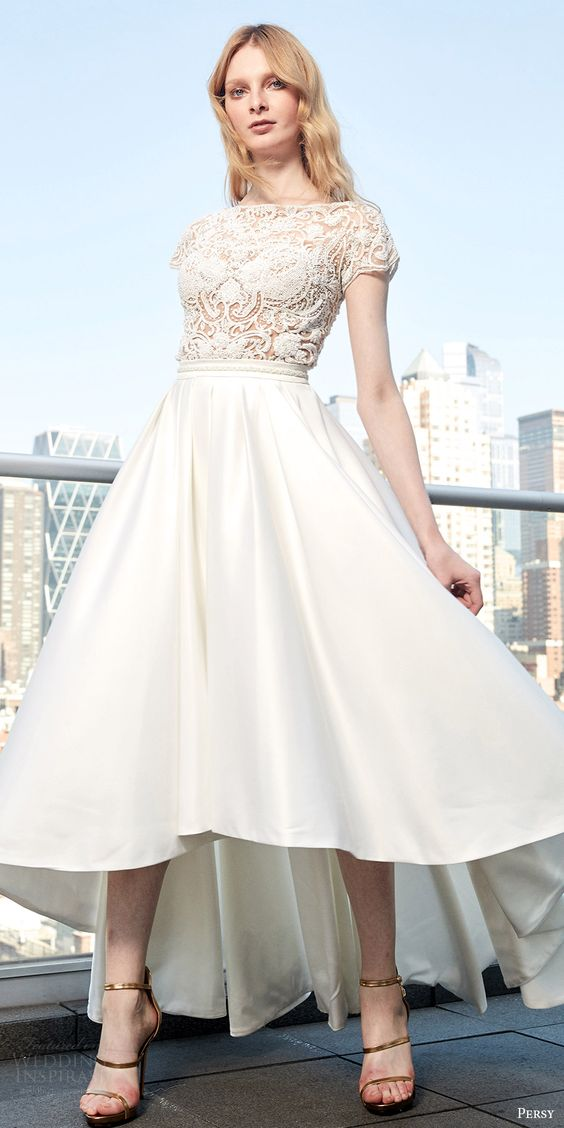 high low wedding dress with a lace bodice and cap sleeves and a plain skirt