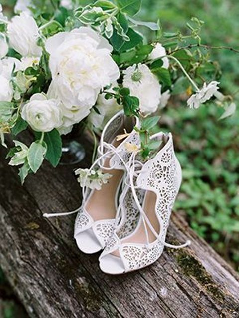 laser cut white bridal booties with lacing