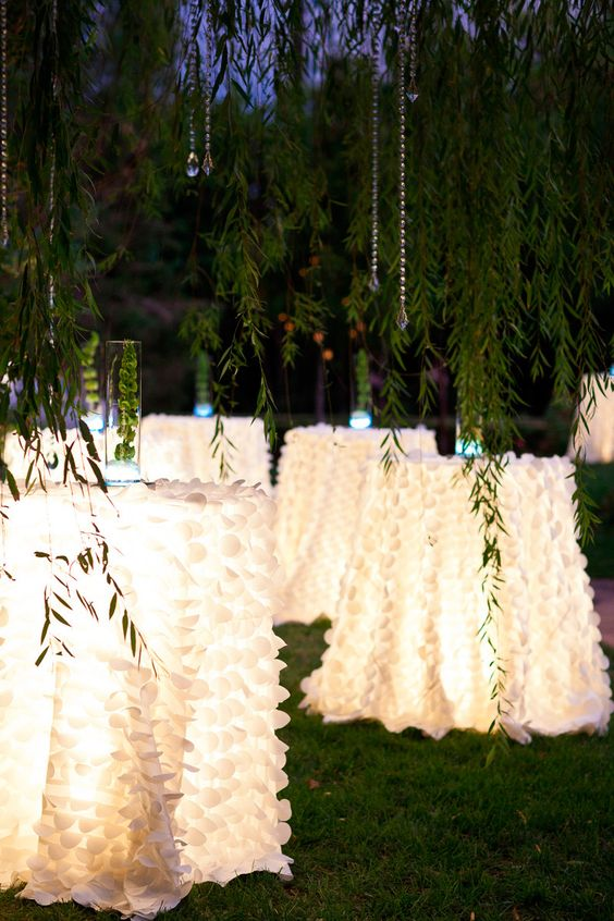 light up the tables from the inside and cover them with long tablecloths