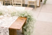 31 long baby's breath garlands on the tables look sweet and elegant yet very trendy