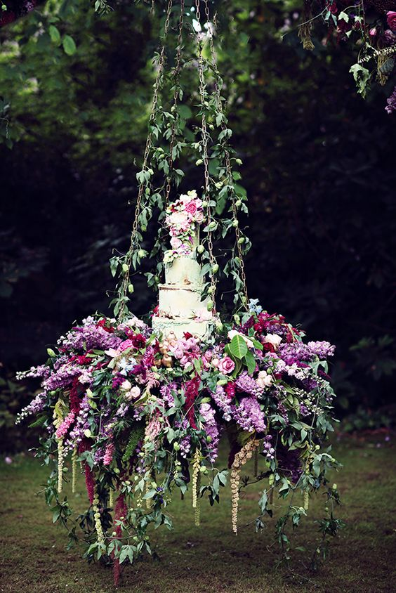 very lush hanging floral cake display for a garden wedding