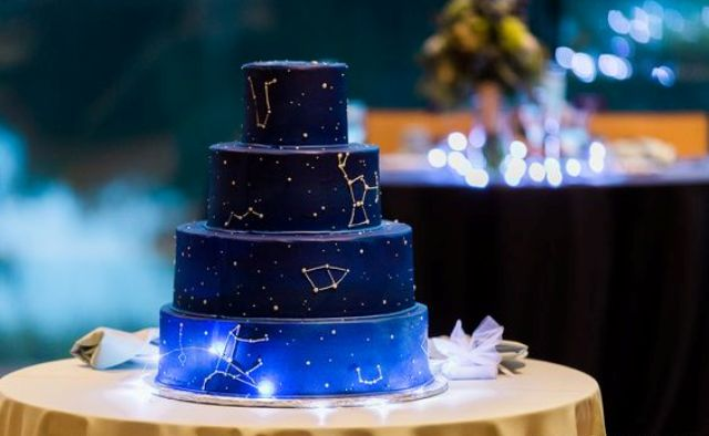 navy and blue cake with different star constellations