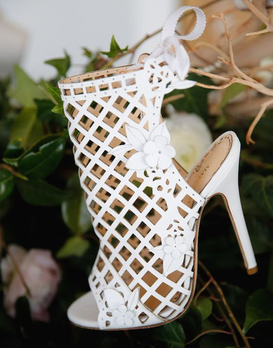 white laser cut wedding bootie with a peep toe and floral detailing