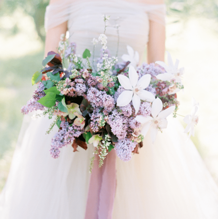This spring wedding shoot was inspired by lush lilac and lots of it was used in decor