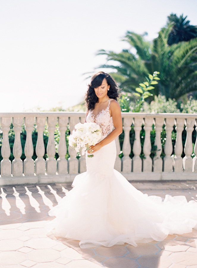 The bride was wearing a gorgeous mermaid wedding dress with an illusion lace bodice and a ruffled skirt