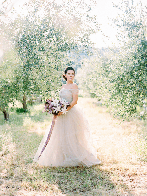 The shoot took place in an olive grove and gentle olive branches completed the look