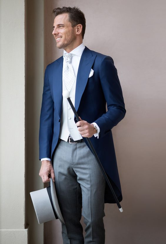 a blue morning suit with a white wasitcoat and grey trousers looks very elegant and formal though the colors add interest