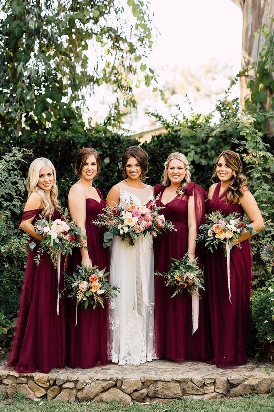 mismatching burgundy bridesmaids' dresses are perfect for the fall
