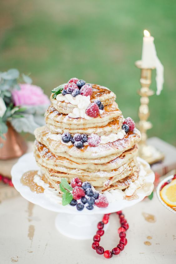 pancake wedding cake with fresh flowers and fruits and sugar powder