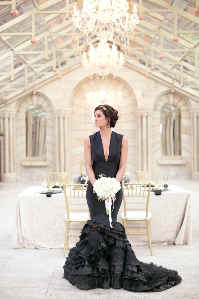 plunging neckline sleeveless mermaid wedding dress with a ruffled tail