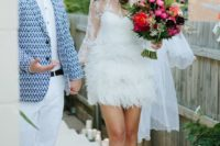 02 short wedding dress with long sleeves, an illusion neckline and a feather skirt