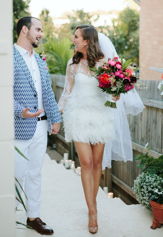 Short Wedding Dress With Long Sleeves An Illusion Neckline And A Feather Skirt
