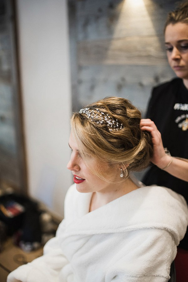 She was rocking a wavy updo with a crystal headband to embrace the season and theme