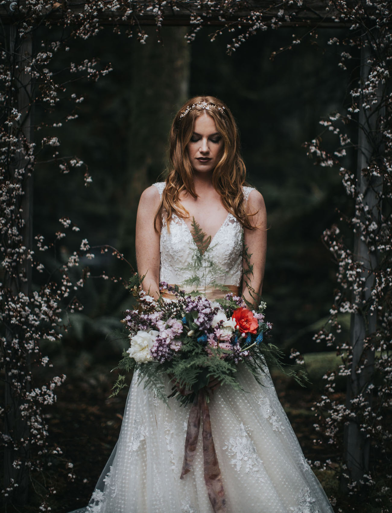 The bride was wearing a V neckline lace bodice wedding dress with a layered tulle and lace applique skirt by Maggie Sottero