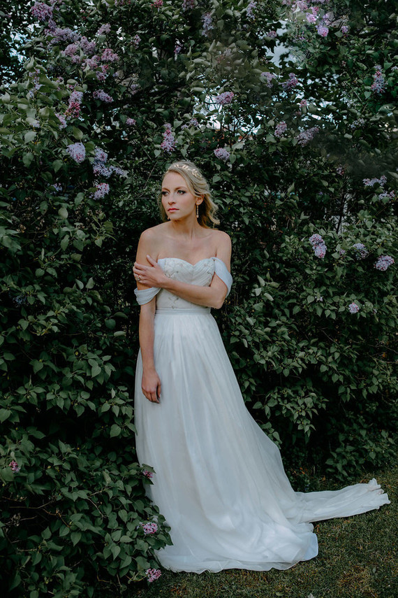 The bride was wearing an off the shoulder wedding dress with a detailed bodice