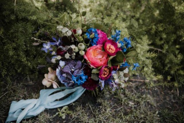 The same bold florals were used for the wedding arch, bridal bouquet and crown