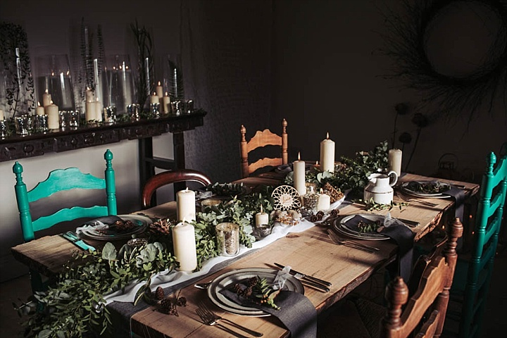 The wedding table setting was done with two fabric runners and a greenery one on top, candles and dream catchers