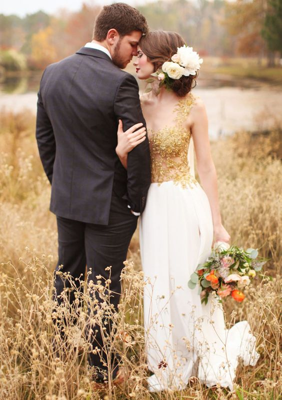 a wedding dress with an illusion sparkling gold bodice