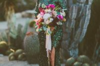 03 emerald sequin long sleeve wedding dress with a scoop neckline and a side slit