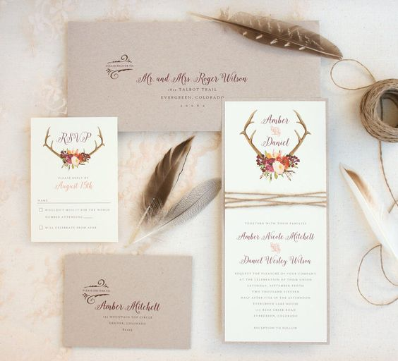 neutral wedding invitation suite in light grey and white with antlers and floral prints