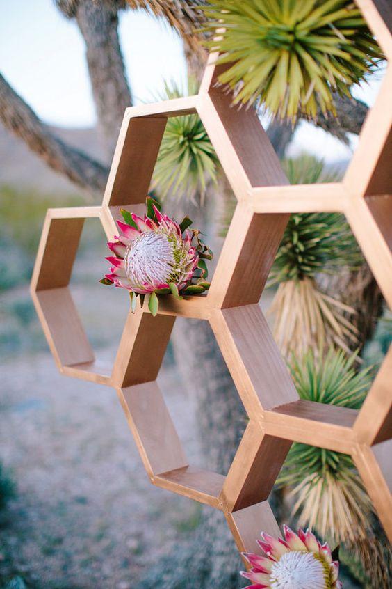 wedding hexagon backdrop with king proteas for a desert wedding
