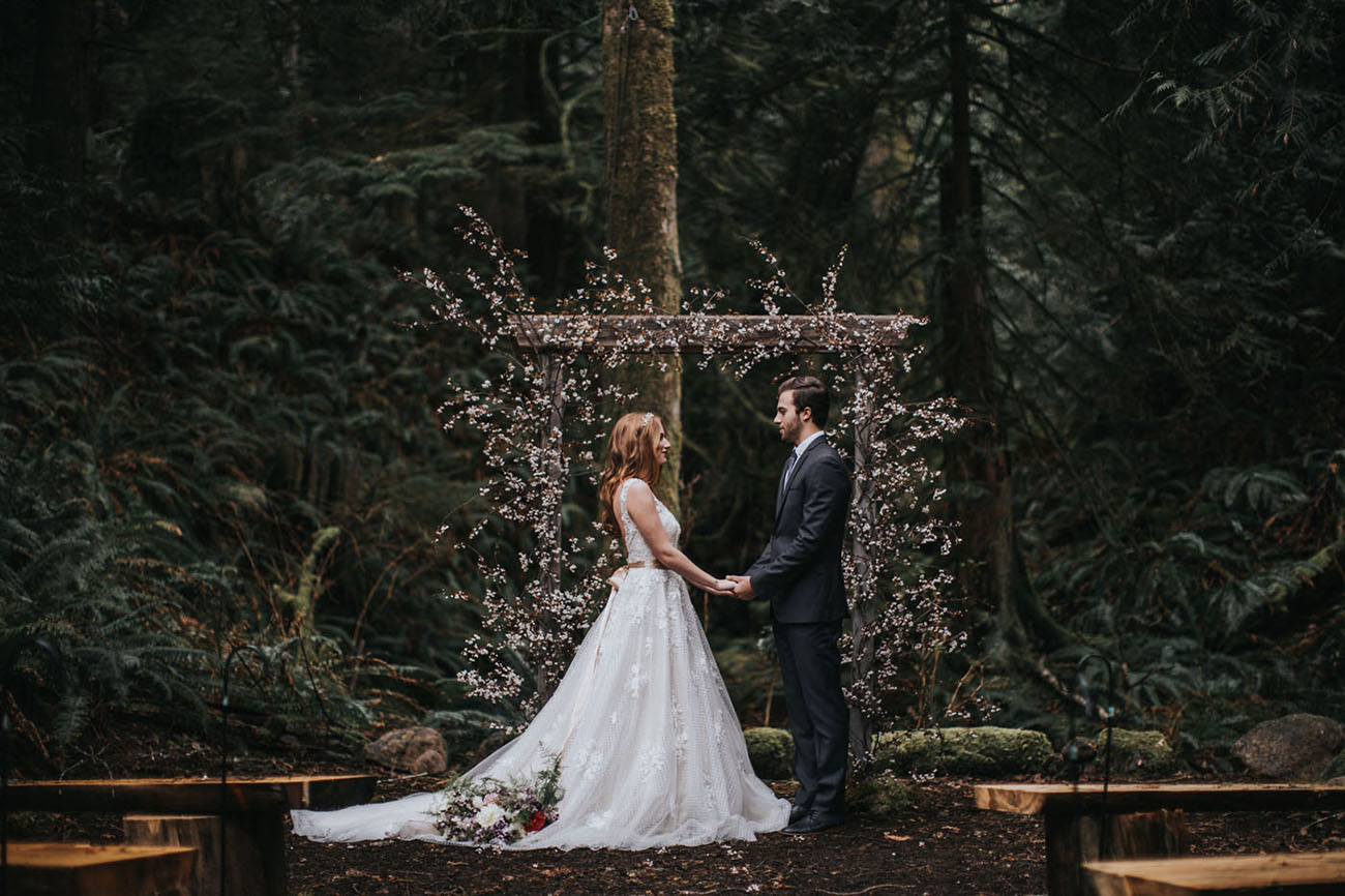 I totally love the cherry blossom wedding arch that immediately make the shoot look spring like
