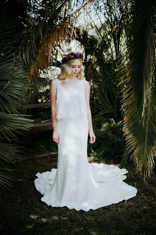 The bride was wearing a separate with a spaghetti strap lace top and a mermaid plain skirt with a train