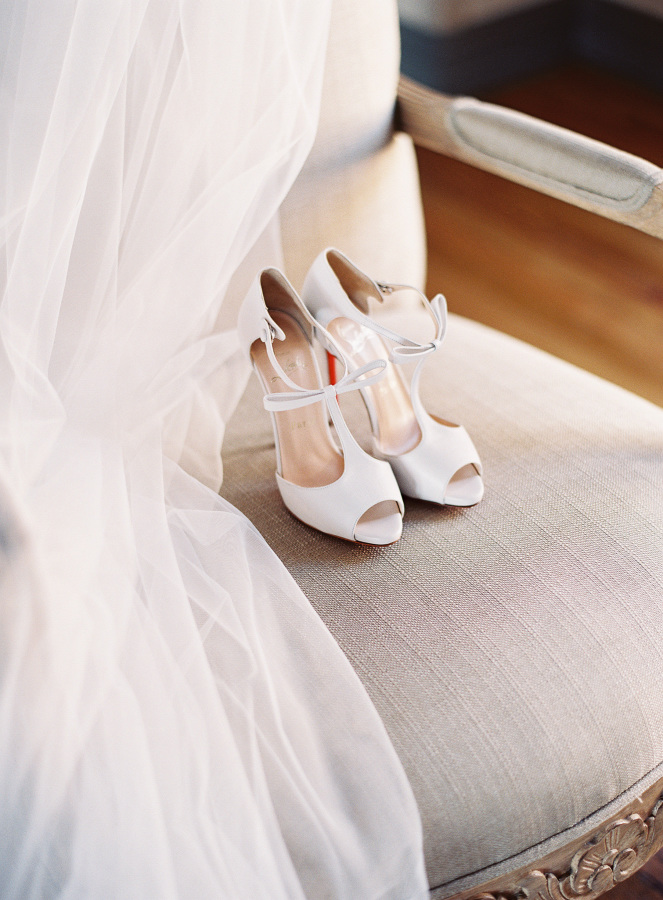 The peep toe ankle strap wedding shoes with bows are pure elegance