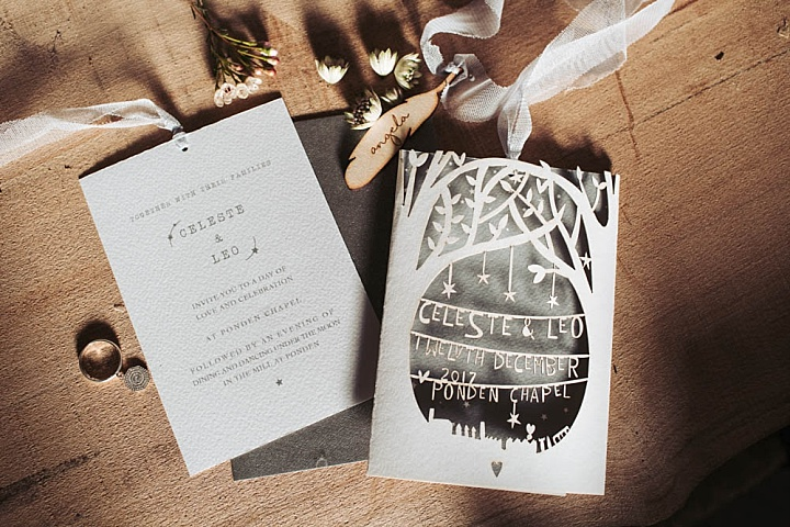 The wedding stationary is done in grey and white, with laser cut detailing