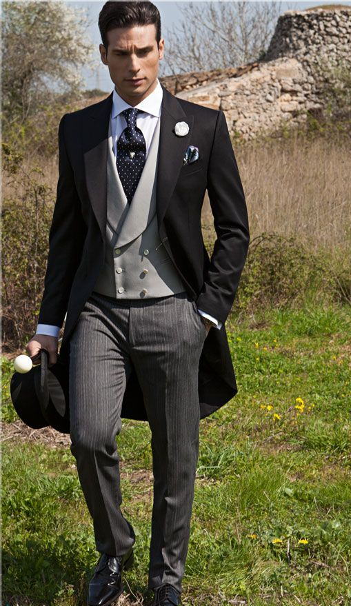 a black morning suit with striped pants and a navy polka dot tie is classics