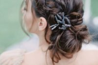 04 beautiful braided updo with messy touches and some lavender tucked in