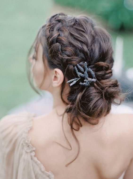 beautiful braided updo with messy touches and some lavender tucked in