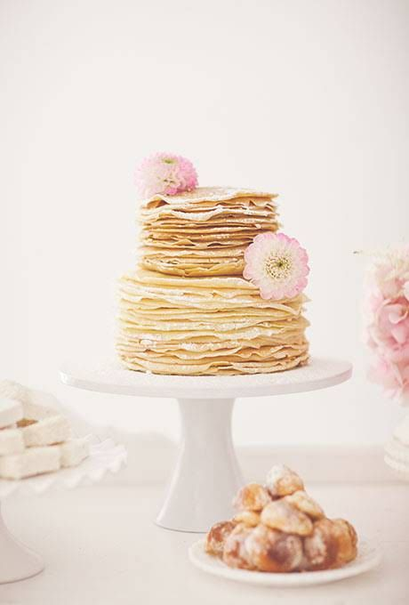 crepe wedding cake with fresh blooms