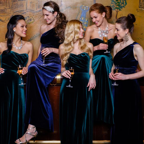 navy and emerald velvet bridesmaids' dresses