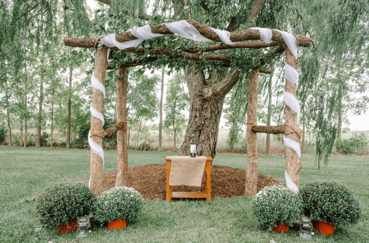 A wedding chuppah was a rustic one, of wood trunks and with lots of greenery and potted flowers around