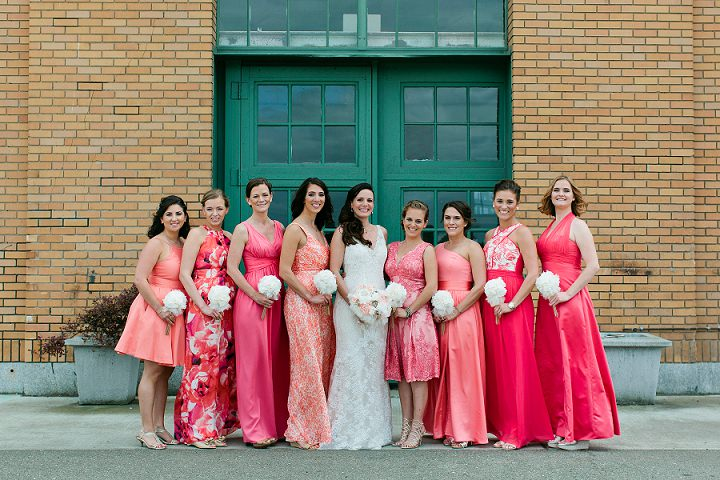 The bridesmaids were wearing mismatched dresses in coral and pink