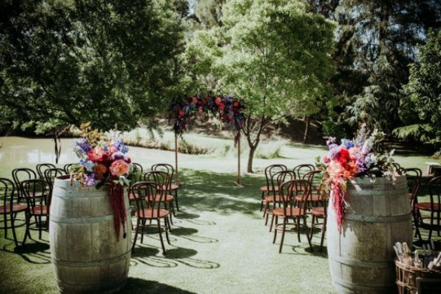 The ceremony space was simple, winery-styled with wine barrels and florals