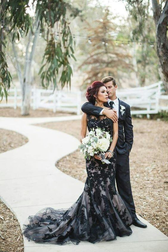 sleeveless cream and black lace wedding dress with a train and no sleeves