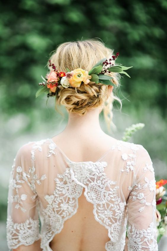 twisted messy bridal updo topped with leaf and fall flower headpiece