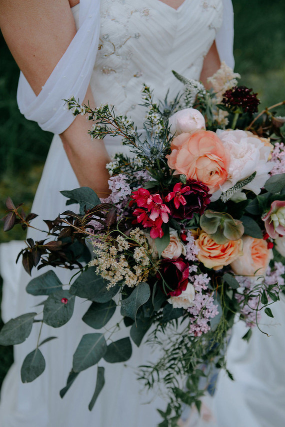 I like the textural bridal bouquet with lots of greenery, orange roses and other blooms, it looked very tender