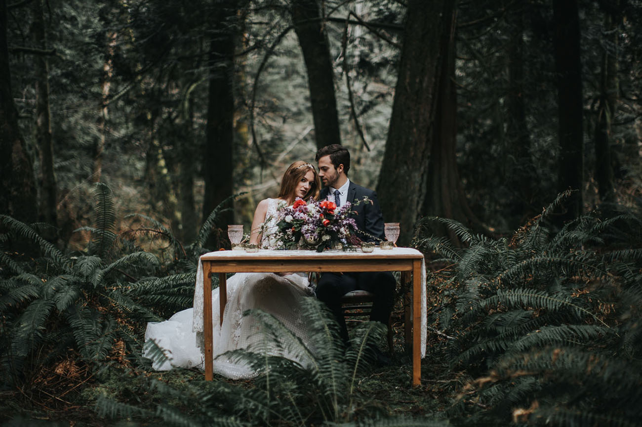 Such magical photos like this one, with the couple sitting in the woods, are stunning