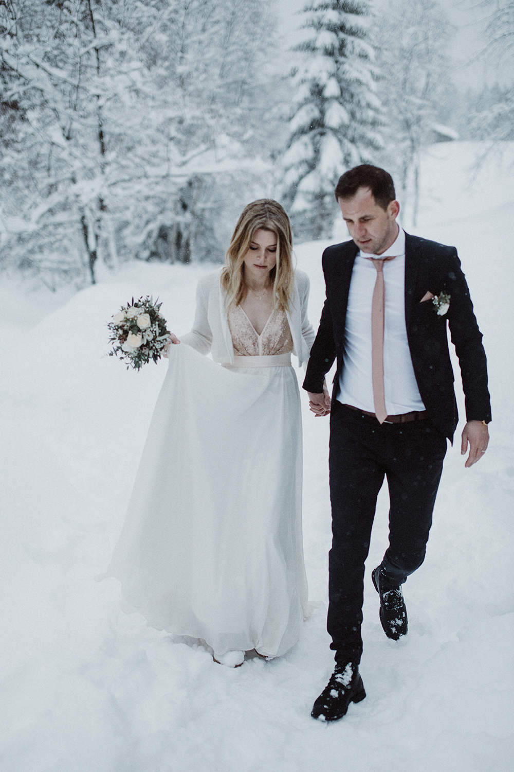 Picture Of The groom was rocking a black suit with a thin tie that ...