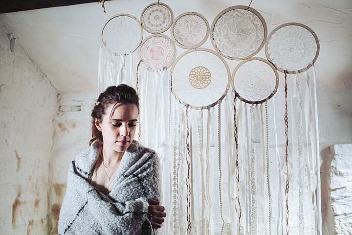 The wedding backdrop was made of dream catchers, doilies and ribbons inserted into embroidery hoops