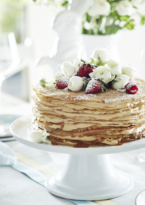 caramel crepe wedding cake with fresh strawberries and white flowers