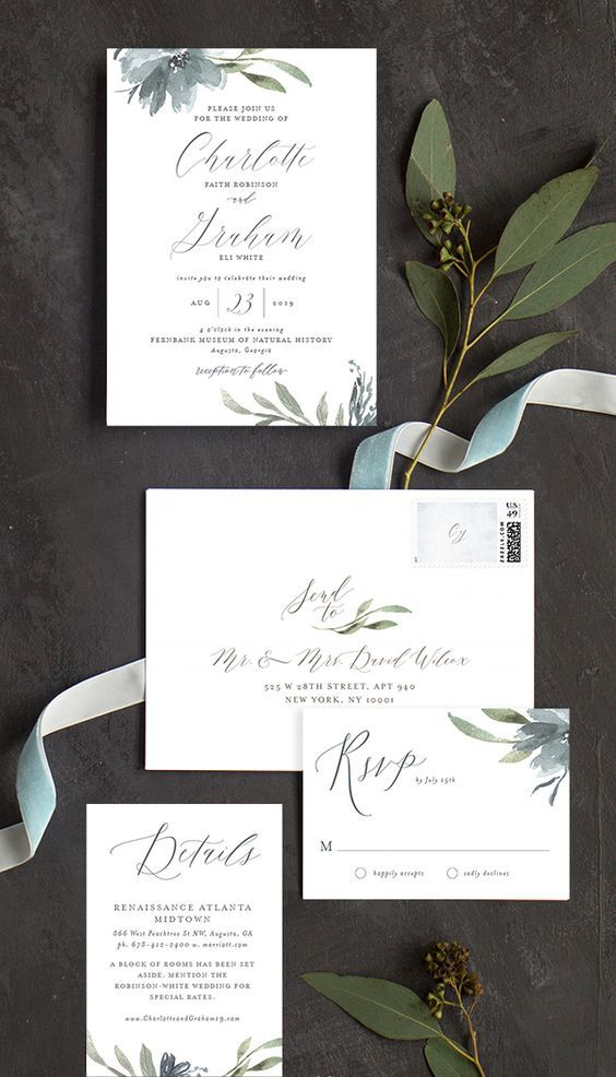 neutral wedding stationary with dusty blue florals and greenery